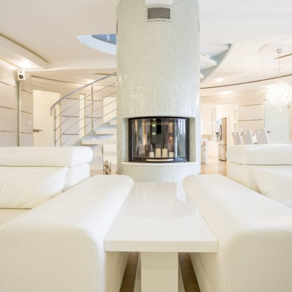 Exclusive spacious lounge with elegant fireplace in wall